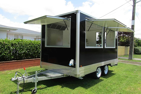 food trailer parked with windows open